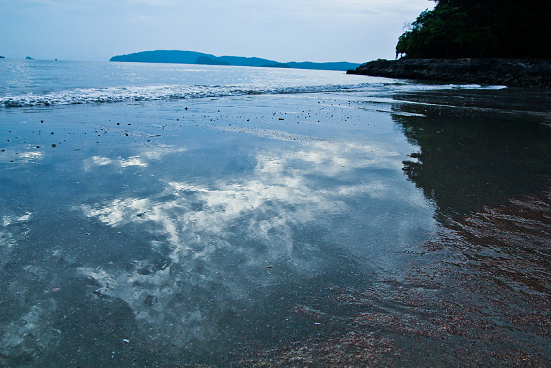 Sky reflection in ocean on the beach